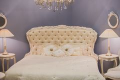Free Luxurious Expensive Interior Design Of The Children`s Girl Room In The Old Style. White Bed, Silk Pillows, Bedside Tables With Ta Stock Images - 120287594