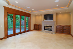 Luxurious Family  Room. Unfurnished Luxurious Family  Room with French doors Stock Photo