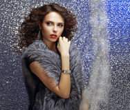 Luxurious Female with Curly Hair and Jewelry. Glamor Royalty Free Stock Photo