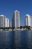 Luxurious Florida Condominiums on Bay. Three luxurious condominiums with docks for yachts and boats on the water in beautiful sunny south Florida Stock Photography