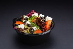 Luxurious fresh colorful vegetable salad on black background. Healthy eating. royalty free stock photos