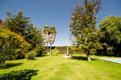 Luxurious garden. With a statue in the background Royalty Free Stock Photography