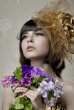 Luxurious girl with flowers in their hands Stock Photos