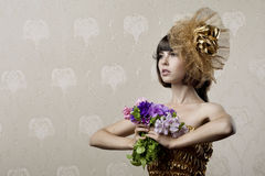 Luxurious girl with flowers in their hands Royalty Free Stock Images