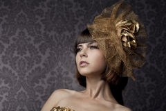 Luxurious glamorous models in gold Stock Photography
