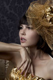 Luxurious glamorous models in gold. Portrait of a beautiful luxurious glamorous models in gold Stock Photos