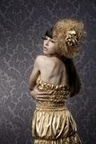 Luxurious glamorous models in gold Stock Photos