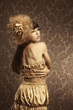 Luxurious glamorous models in gold Royalty Free Stock Images
