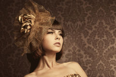 Luxurious glamorous models in gold. Portrait of a beautiful luxurious glamorous models in gold Stock Photo