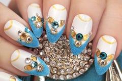 Luxurious glamorous sandy blue French manicure. Royalty Free Stock Photo