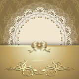Luxurious gold background with napkin. Elegant template luxury invitation, gift card with lace ornament, ribbon, silk bow, place for text. Floral elements Stock Photo