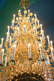 Luxurious gold chandelier. Fragment of the luxurious gold chandeliers Royalty Free Stock Image