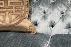 Luxurious Gold Cushions on Expensive Blue Sofa Stock Photography