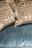 Luxurious Gold Cushions on Expensive Blue Sofa Stock Image