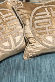Luxurious Gold Cushions on Expensive Blue Sofa Royalty Free Stock Photos