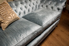 Luxurious Gold Cushions on Expensive Blue Sofa Stock Photo