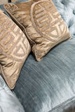 Luxurious Gold Cushions on Expensive Blue Sofa Royalty Free Stock Photo