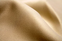 Luxurious gold fabric Royalty Free Stock Photos
