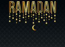 Luxurious golden Ramadan text with hanging decorations. On dark background Stock Photos