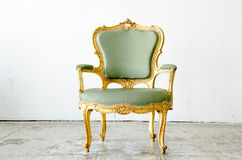 Luxurious green classical style Armchair sofa couch in vintage r Royalty Free Stock Photos