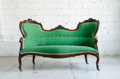 Luxurious green classical style Armchair sofa couch in vintage r Stock Photos