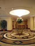 Luxurious hall. Big marble and granite hall with table and flower bouquet Royalty Free Stock Photography
