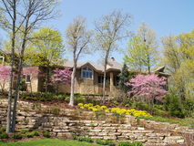 Luxurious home in springtime. Luxurious home with beautiful springtime flowers Royalty Free Stock Photos