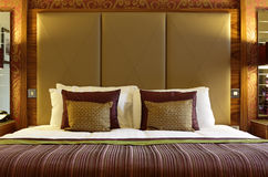 Luxurious hotel bed Stock Photos
