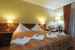 Luxurious hotel bedroom Stock Photos