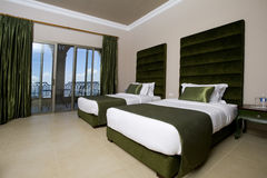 Luxurious hotel bedroom with balconies, 5 stars luxury hotel bedroom Royalty Free Stock Photos