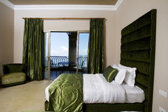 Luxurious hotel bedroom with balconies, 5 stars luxury hotel bedroom Stock Image