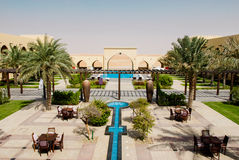 Luxurious hotel pool complex. Luxury hotel and pool complex set in the desert, UAE Royalty Free Stock Image