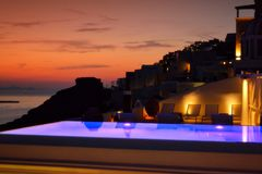 Luxurious hotel pool sunset view Santorini Greece royalty free stock photography