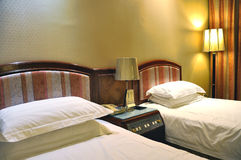 Luxurious Hotel Room. With two separate beds royalty free stock photography