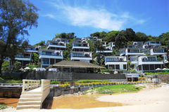 Luxurious hotel by the sea and sewerage flowing to the beach. Conceptual contrast. Ecological disaster Stock Image
