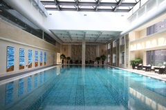 Luxurious hotel swimming pool. Luxurious swimming pool in the Mayfair residential compound in Shanghai, China Royalty Free Stock Image