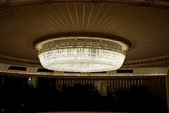Luxurious huge chandelier in the Vienna State Opera - Wiener Staatsoper. royalty free stock photography