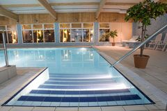 Luxurious indoor swimming pool Stock Image
