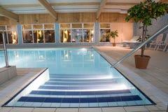 Luxurious indoor swimming pool stock image