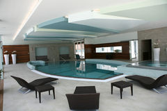 Luxurious interior. Luxurious spa/wellness interior with a swimming pool royalty free stock photography