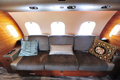 Luxurious interior of Bombardier Global 6000 executive jet at Singapore Airshow. SINGAPORE - FEBRUARY 12: Luxurious interior of Bombardier Global 6000 executive Royalty Free Stock Photography