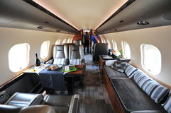 Luxurious interior of Bombardier Global 6000 executive jet at Singapore Airshow. SINGAPORE - FEBRUARY 12: Luxurious interior of Bombardier Global 6000 executive stock photography