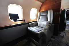 Luxurious interior of Bombardier Global 6000 executive jet at Singapore Airshow. SINGAPORE - FEBRUARY 12: Luxurious interior of Bombardier Global 6000 executive Stock Images