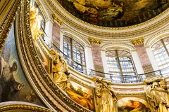 The luxurious interior of the temple. Luxurious interior of the Christian Church. The decoration of the Cathedral of gold. On the walls painting. Paintings and stock photography