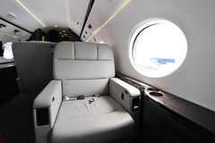 Luxurious interior of Gulfstream G450 executive jet at Singapore Airshow. SINGAPORE - FEBRUARY 12: Luxurious interior of Gulfstream G450 executive jet at royalty free stock photo