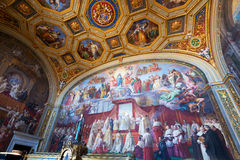 Luxurious interior of one of the rooms of the Vatican museum. VATICAN - MAY 14, 2014: Luxurious interior of one of the rooms of the Vatican museum. Frescoes of royalty free stock photography