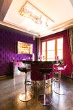 Luxurious interior with a round bar table with bar stools Stock Photo