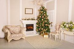 Luxurious interior with white Christmas tree and fireplace. Stock Image