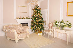 Luxurious interior with white Christmas tree and fireplace. Royalty Free Stock Photography
