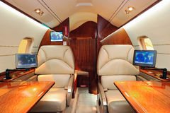 Luxurious jet airplane. Interior of luxurious jet airplane stock photography